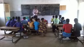 A teacher with his class
